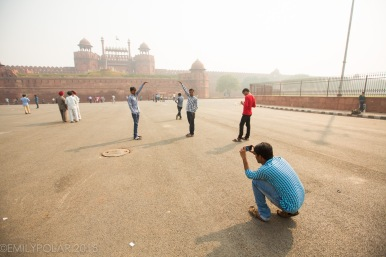 Tourists taking pictures of eachother at the Red Fort in Old Delhi, India.