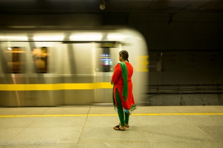 Woman waiting for metro in Old Delhi, India.