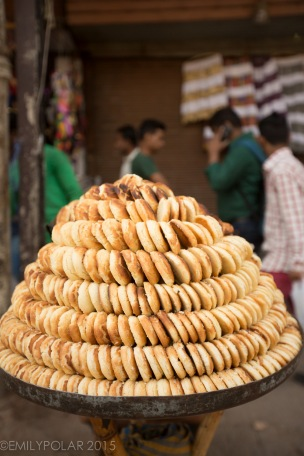 Fried dough stacked in a spiral being sold at a street vendor in Old Delhi, India.