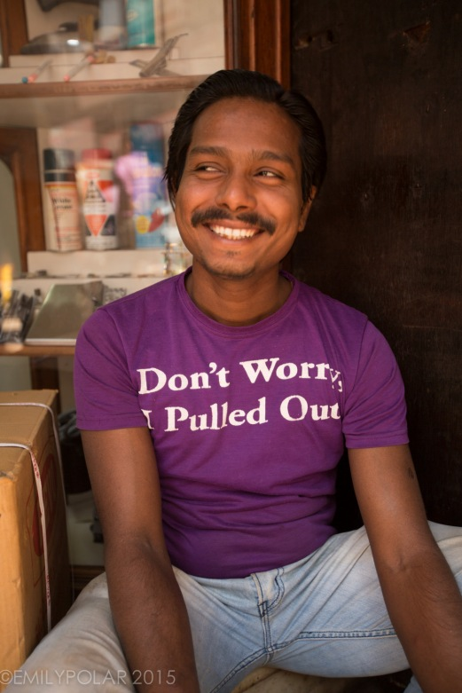 "Indian man wearing an American T-Shirt that says ""Don't worry, I pulled out"" Old Delhi, India."