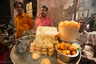 Indian men selling food at a street cart in Old Delhi, India.