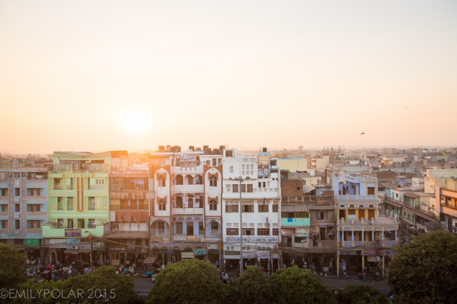 View of hotels stacked next to each other at sunset in Old Delhi, India.