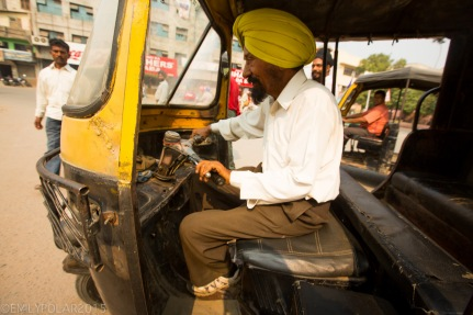 Rickshaw driver wearing yellow turban in the streets of Amritsar.