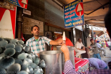 Man selling frozen treats at his street stall in Amritsar.