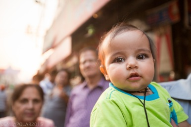 Cutest baby face with big brown eyes in the streets of Amritsar.