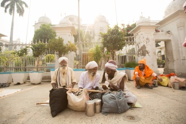 Holy men living out of their bags sitting on the streets of Amritsar next to the Golden Temple.