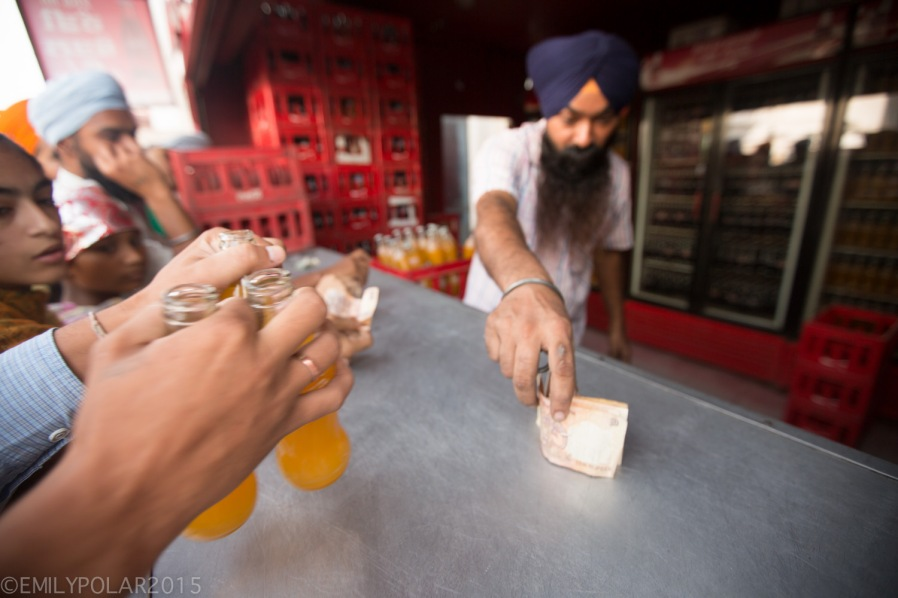 Punjabi man working the Coca Cola counter at the Golden Temple.