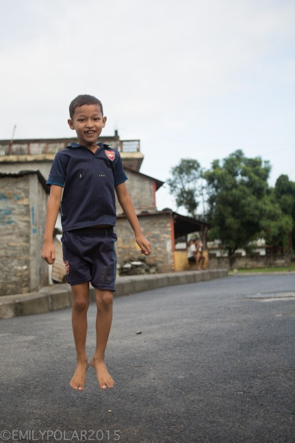 Young Nepali boy jumping in the streets of Pokhara.