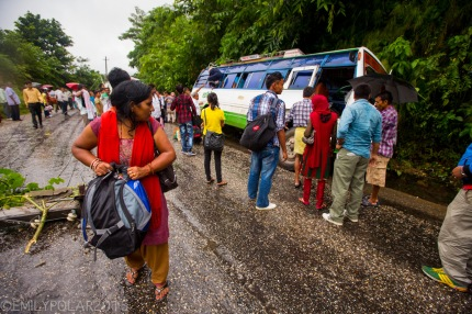 Locals and travelers standing around after mini bus crashed into another bus along the road to Pokhara, Nepal.