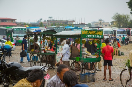 Fruit and juice stands on wheels at the bus station in Pokhara, Nepal.