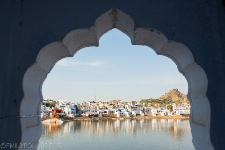 Pushkar lake surrounded by holy ghats, temples, guest houses and forts in Pushkar, Rajasthan.