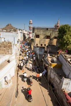 Indian people walking in the streets cheering for elections in Pushkar, India.