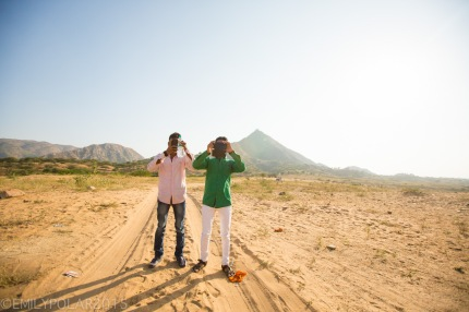 Two Indian men stop to take a picture of Westerners with their smart phones in Pushkar, India.