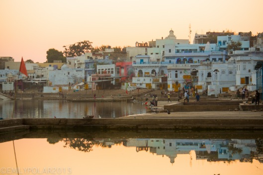 Glowing Pushkar reflects in the lake at sunset.