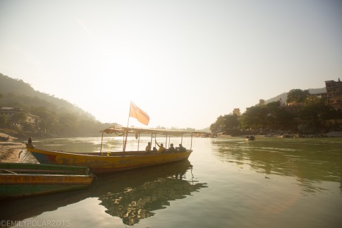 Wooden boat docked on the banks of the Ganges river in Laxman Jhula Rishikesh.