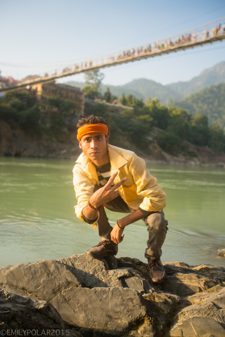 Funny portraits of Hindu boys posing under the Laxman Jhula Bridge along the Ganges River, Rishikesh.