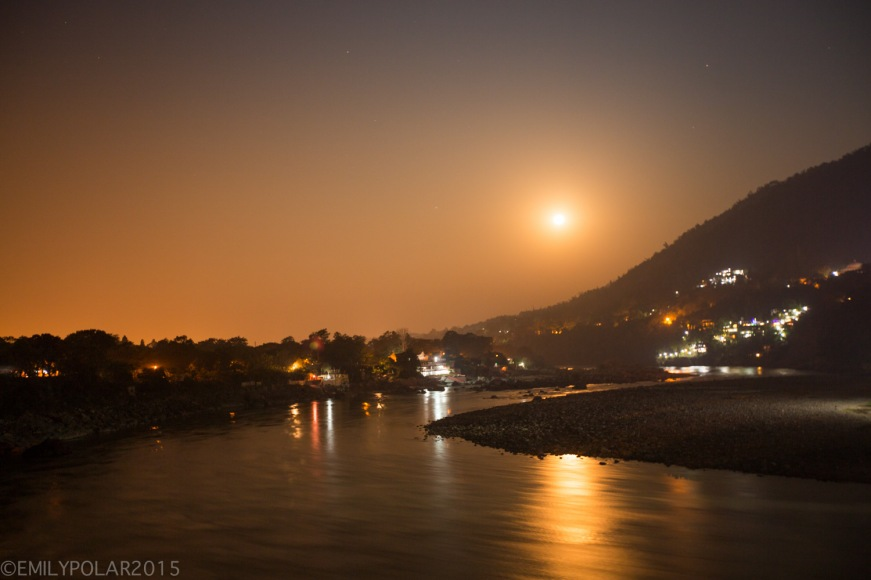 Full moon setting over the Ganges river in Laxman Jhula, Rishikesh.