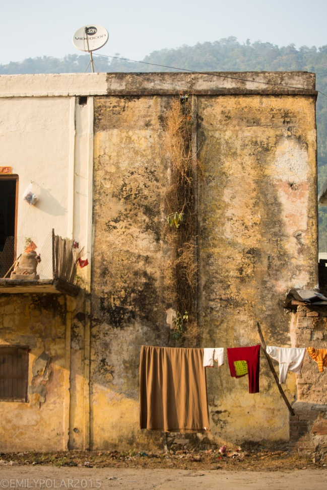 Clothes drying on the line in front of a old painted wall in Rishikesh, India.