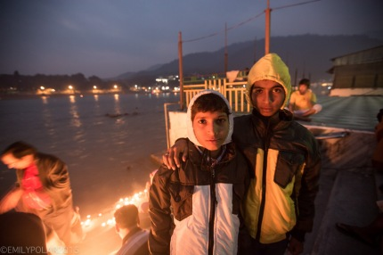 Portrait of two Indian boys at puja at the Ghat near Ram Jhula in India.