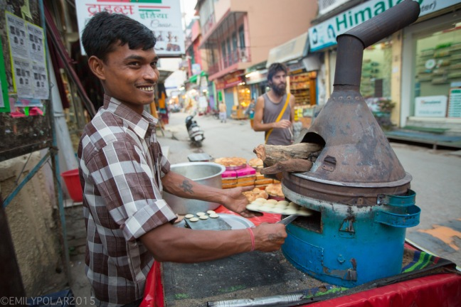 Local Indian man selling best butter cookies at street cart in Laxman Jhula, Rishikesh.