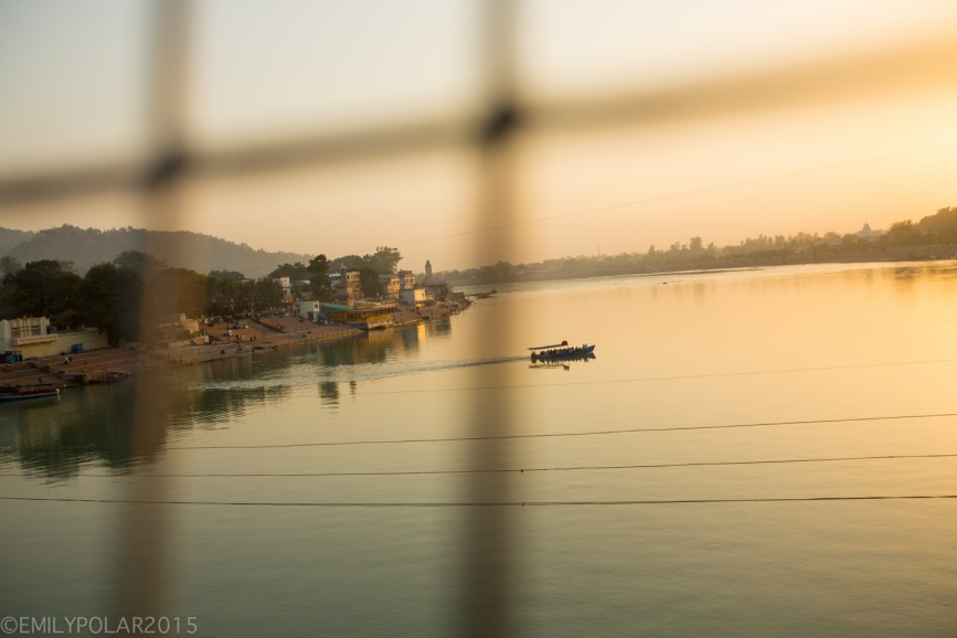 Boat shuttle chugging across the ganges at sunset in Ram Jhula, Rishikesh.
