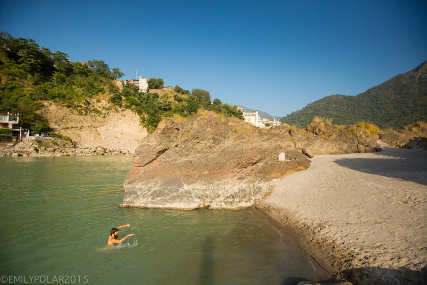 Man jumping off Hanuman rock into the Ganges in Rishikesh, India.