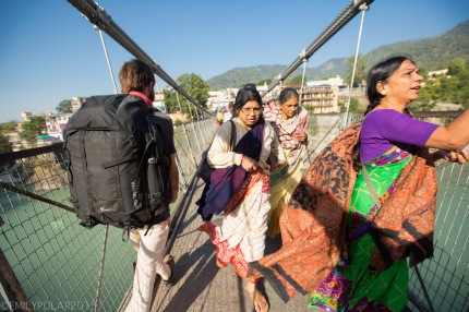 Traveling man walking on Laxman Jhula Bridge in RIshikesh, India.