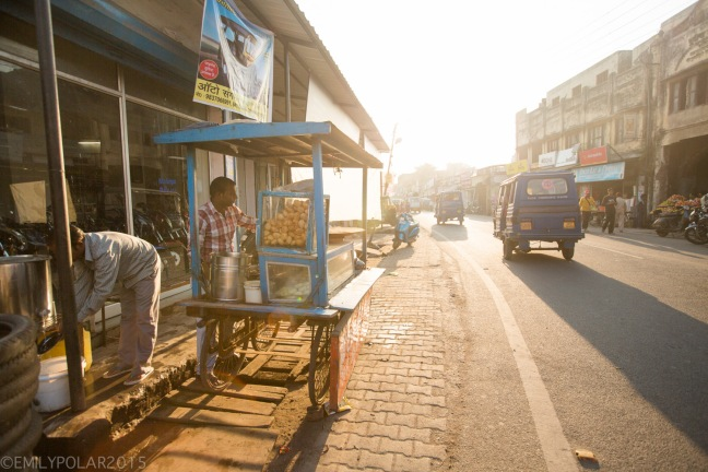 Busy street scenes at sunset in Rishikesh, India.