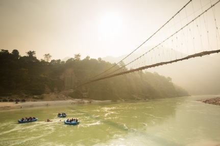 Tourists rafting down the Ganges under an old bridge en route to Rishikesh.