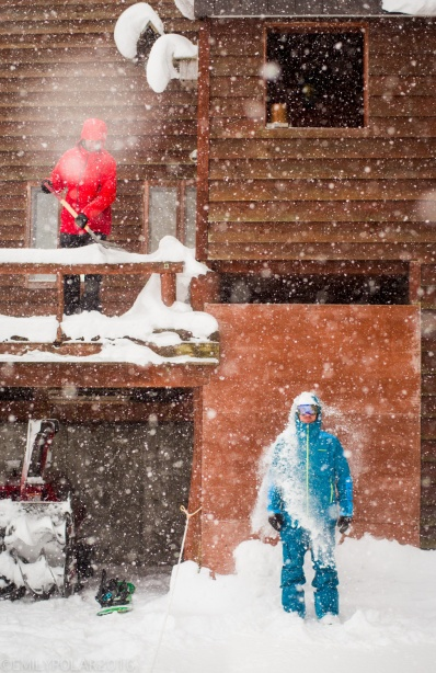 Snowboarders shoveling snow off the patio and playing in the endless powder of Japan, Niseko.