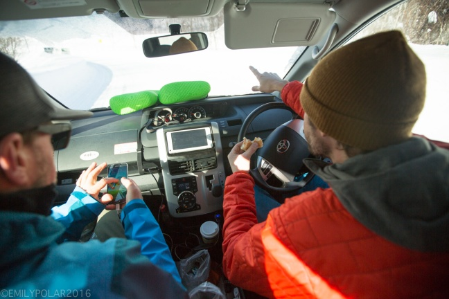Snowboarders in the van navigating to the backcountry for a day of riding in Niseko, Japan.