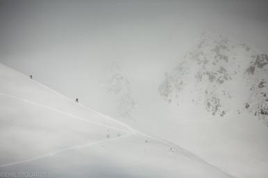 Skiers and snowboarders skin their way up a mountain peak at Goshiki in Niseko, Japan.