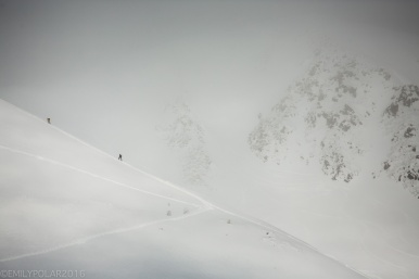 Skiers and snowboarders skin their way up a mountain peak at Goshiki in Niseko, Japan.
