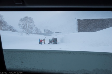 Friends haning out in the parking lot at the base of Goshiki while it continues to dump in Niseko, Japan.