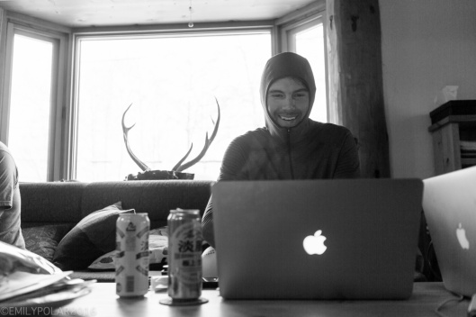 Snowboarder checking out tomorrows weather in Patagonia base layer in the cozy cabin in Niseko, Japan.