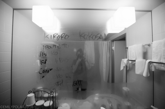 Taking a photo of a steamy mirror in hotel room with list of stops and directions to Niseko, Japan.