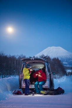 Snowboardes enjoying some ramen in the back of the van after a some backcountry riding in Niseko, Japan.