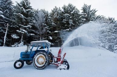 Huge tractor snow plow blowing snow in Hokkaido, Japan.