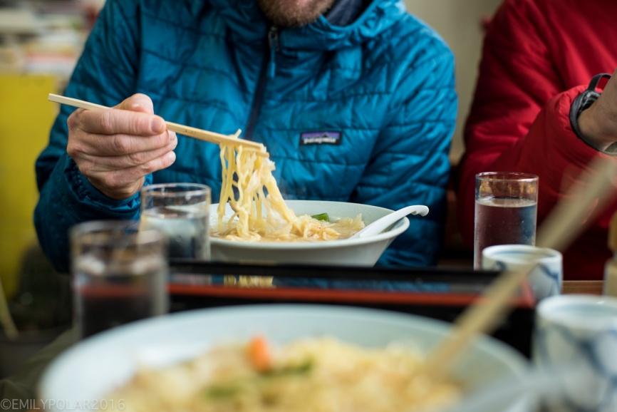 Snowboarders eating ramen at a small Japanese restaurant in rural Hokkaido.