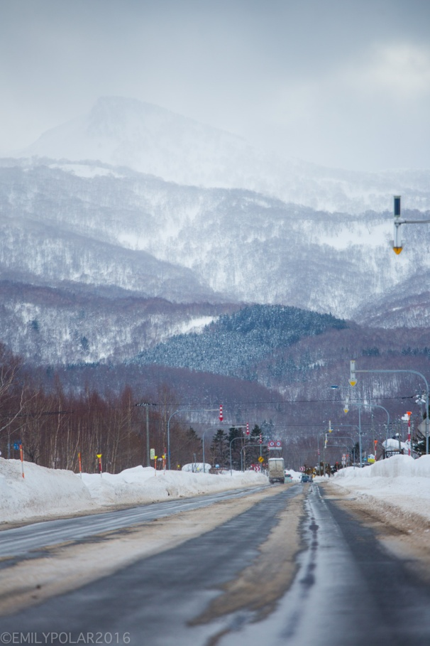 Winter roads wet with ice and snow in Niseko, Japan.
