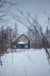 Cute wood cabin home in the countryside of Hokkaido, Japan.