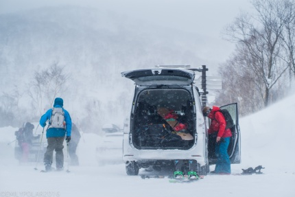 Snowoboarders getting gear ready for a backcountry tour at Nito in Niseko, Japan.