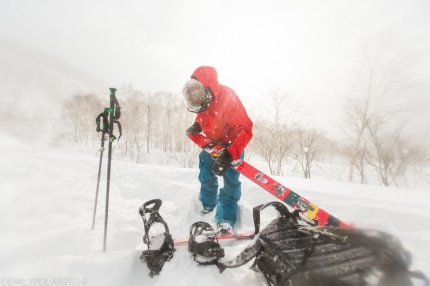 Snowboarders putting their skins back on for another lap in the Nito backcountry of Niseko, Japan.