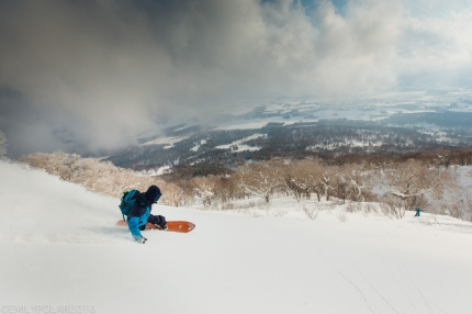 Ken Miyashita snowboarding fresh powder on Mt. Yotei in Niseko, Japan.