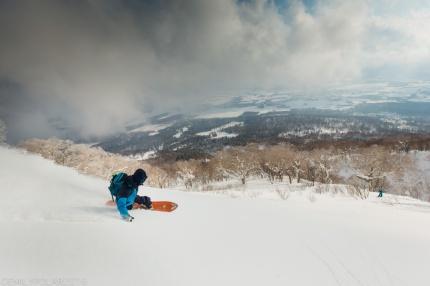 Ken Miyashita snowboarding fresh powder on Mt. Yotei in Niseko, Japan.