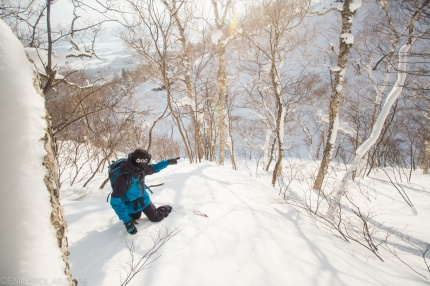 Ken Miyashita navigating the way down a snowy gully on the run out on Mt. Yotei in Niesko, Japan.
