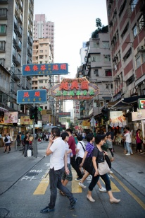 Chinese tourists walking around Mong Kok. Shopping in the streets of China.