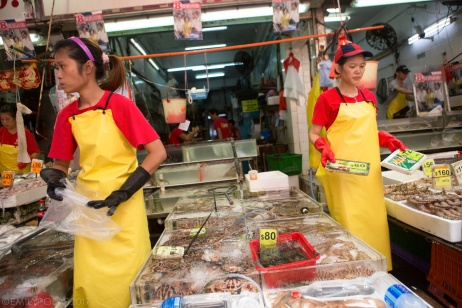 Chinese women workers bring fish out at the market in Central Hong Kong. Women working at fish market.