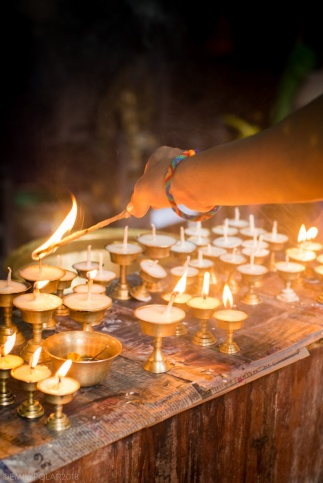 Butter lamps at the Golden Temple in Patan, Kathmandu, Nepal.