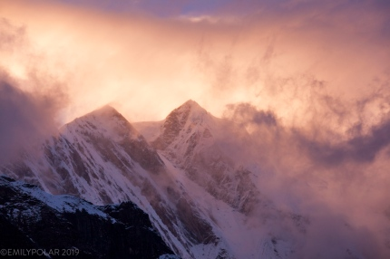 Fast moving clouds churning on Annapurna South ridge turning the Himalaya landscape into a magical landscape.